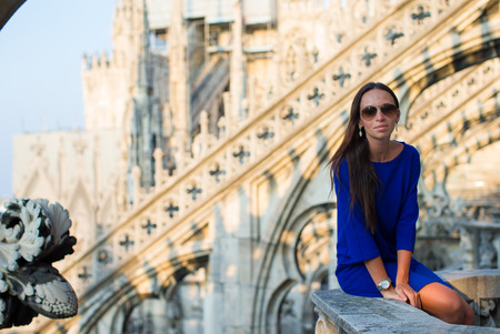 Beautiful woman on on the rooftop of Duomo, Milan, Italy photo