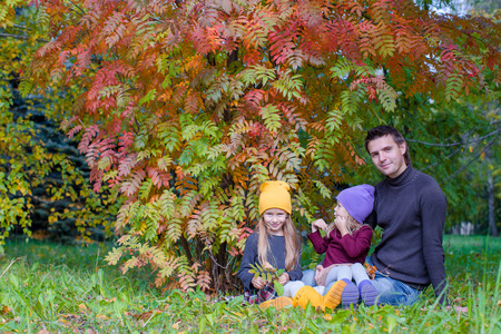 Cute little girls with happy dad enjoy autumn vacation photo