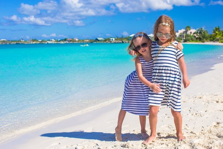 youngbaby: Two little adorable girls during tropical beach