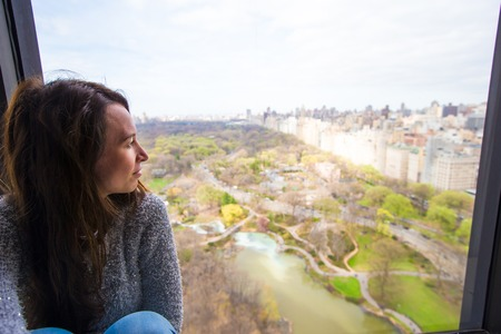 woodland hotel: Young girl with view of Central Park Stock Photo