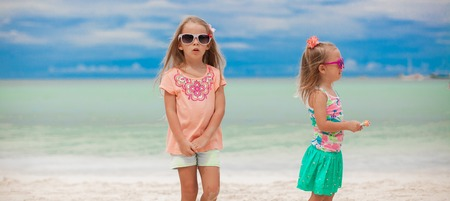 youngbaby: Two little girls during tropical beach