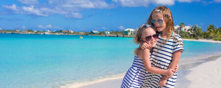 youngbaby: Two little adorable girls enjoy tropical beach vacation