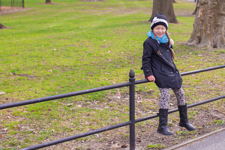 Adorable little girl in Central Park at New York City photo