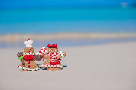 Christmas gingerbread man cookies on a white sandy beach photo