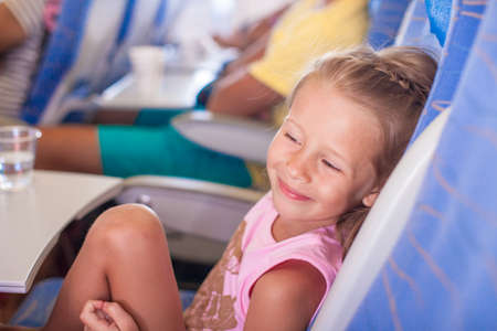 Little smiling happy girl in the aircraft photo