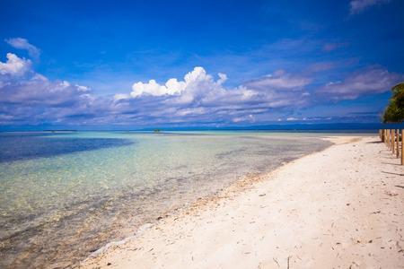 Beautiful white tropical beach on desert island photo