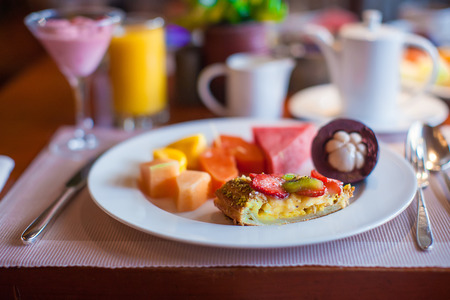 philippino: Philippino breakfast with juicy fruits and black coffee Stock Photo