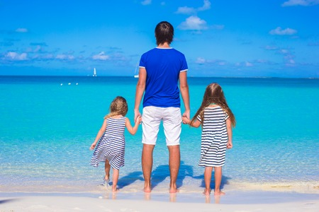 Father and little cute girls during tropical vacation photo