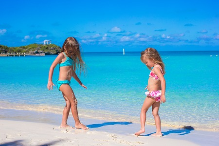 youngbaby: Little girls enjoy their summer vacation on the beach