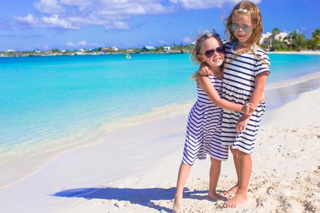 youngbaby: Adorable little girls enjoying summer beach vacation