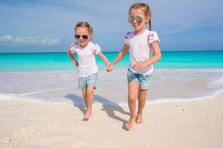 youngbaby: Little cute girls enjoy their summer vacation on the beach