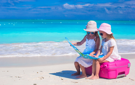 Little girls at tropical beach while summer vacation Stock Photo