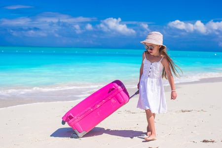 beach hat: Adorable little girl during beach vacation have fun