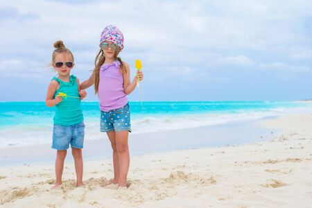 youngbaby: Little adorable girls on white tropical beach