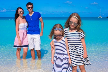 Young happy family with two kids on summer vacation photo
