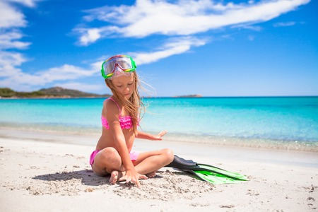 snorkling: Little girl with flippers and goggles for snorkling