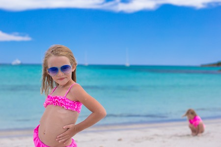 Adorable little girl have fun during tropical beach
