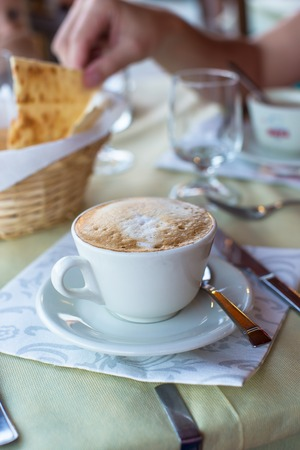 Delicious and tasty cappuccino for breakfast at cafe photo