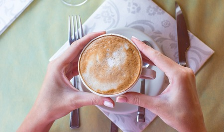 Delicious, aromatic cappuccino for breakfast at a cafe in the resort photo