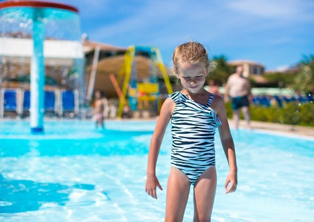 leisure wear: Little girl at aquapark during summer holiday Stock Photo