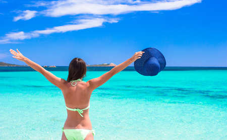 vacation destination: Happy young girl enjoy tropical beach vacation
