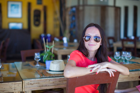 Young girl in outdoor cafe enjoy her vacation photo