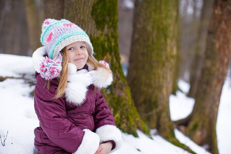 Adorable little happy girl have fun during winter vacation photo