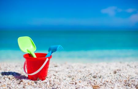 Beach kids toys on white sand beach photo