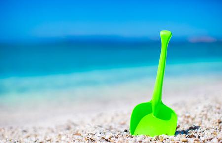 Summer kids beach toy in the white sand photo