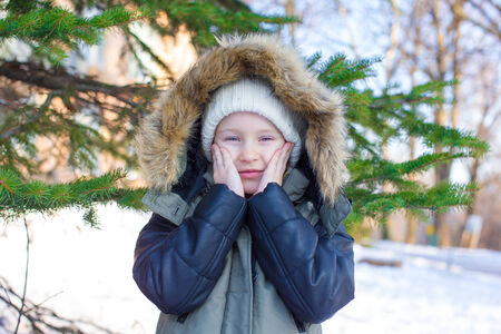 Little adorable girl outdoor during winter vacation photo