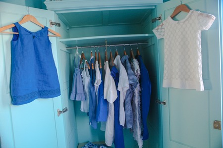 coordinate: Dressing closet with blue clothes in the closet Stock Photo