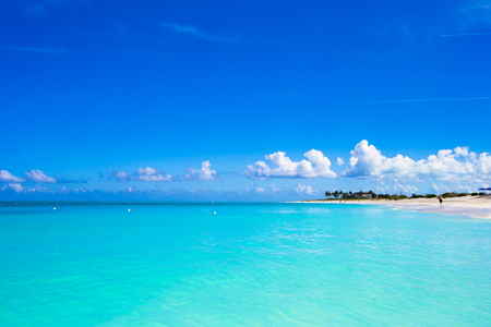 White sandy beach with turquoise water at perfect island Stock Photo
