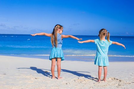 youngbaby: Little adorable girls on summer vacation at tropical beach