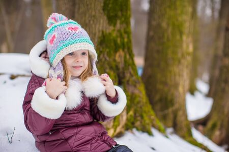 Portrait of cute little girl outdoors on warm winter day photo