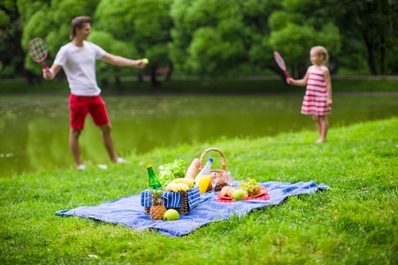 picnicking: Happy family picnicking in the park