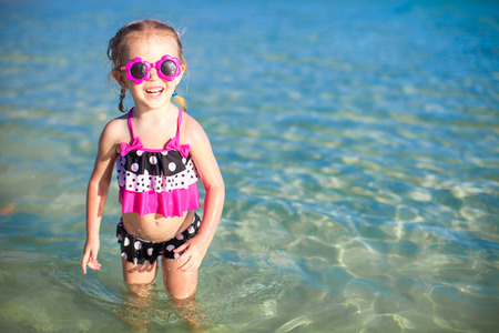 shallow water: Happy little girl having fun at shallow water