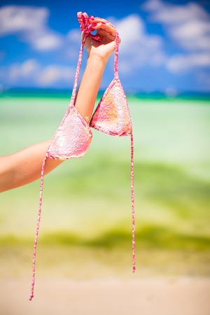 Pink swimsuit on background of turquoise tropical sea Stock Photo
