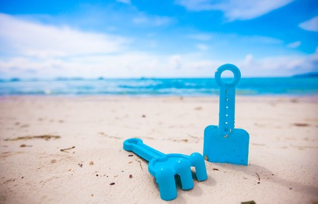 Summer kids beach toys in the white sand photo