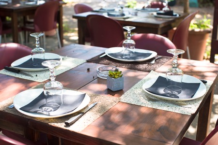 Outdoor served cafe in european city on summer time photo