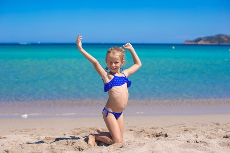 white beach: Adorable little girl have fun on tropical white sandy beach