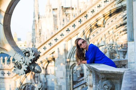 church buildings: Beautiful woman on the rooftop of Duomo, Milan, Italy