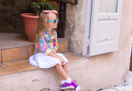 Adorable little girl outdoors in European city photo