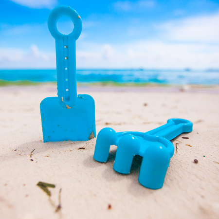 Summer kids beach toys in the white sandy beach photo