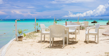Outdoor white cafe on tropical beach photo
