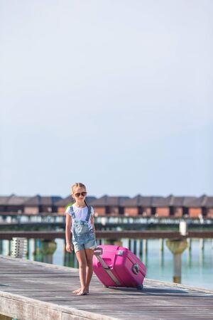 portmanteau: Little adorable girl with big luggage during summer vacation