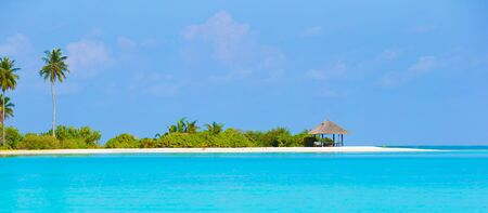 Perfect island with white beach, turquoise water and green palms