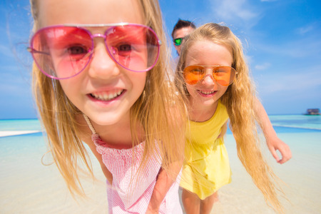 Portrait of beautiful family during summer tropical vacation photo
