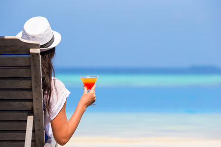 natural pool: Young woman with cocktail glass near swimming pool