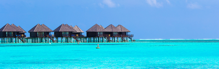 bungalows: Water villas, bungalows on ideal perfect tropical island Stock Photo