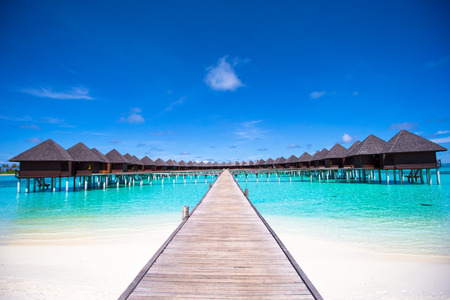 bungalows: Water bungalows and wooden jetty on Maldives